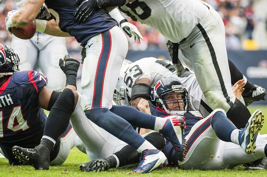Texans quarterback Case Keenum looks back as tight end Garrett Graham recovers his fumble. Photo: Smiley N. Pool, Houston Chronicle