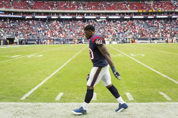 Texans wide receiver Andre Johnson walks off the field in the final minute of the game.