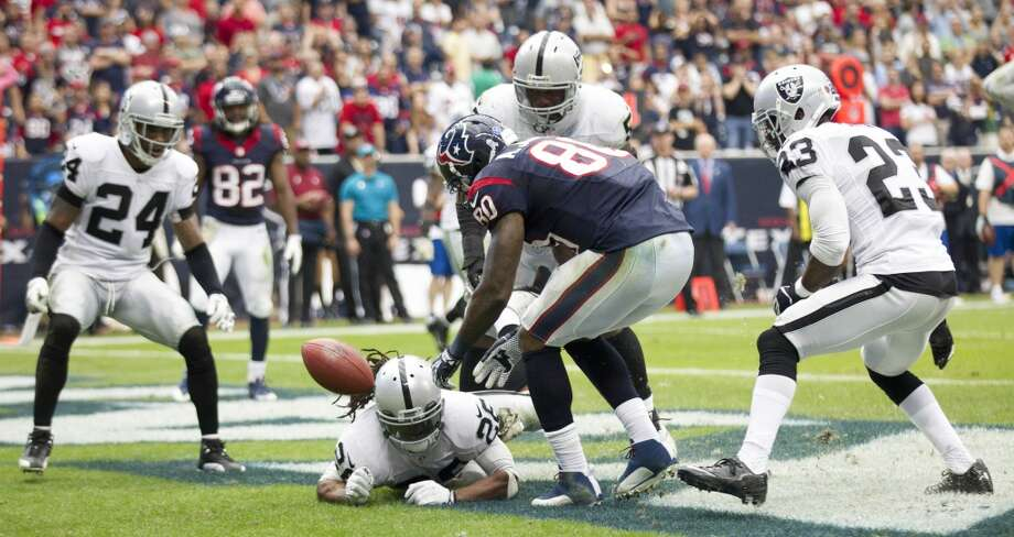 Raiders free safety Usama Young (26) knocks down a pass in the end zone intended for Texans wide receiver Andre Johnson. Photo: Brett Coomer, Houston Chronicle