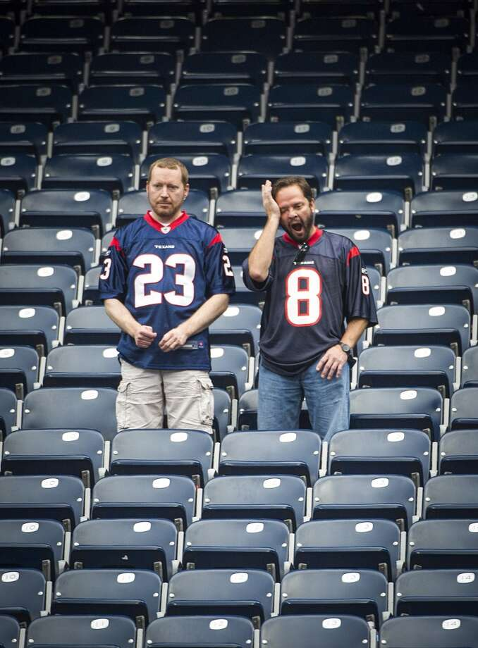 Texans fans linger in the stadium after a loss to the Raiders. Photo: Smiley N. Pool, Houston Chronicle