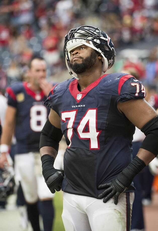 Texans guard Wade Smith looks up at the scoreboard as the final seconds tick away. Photo: Smiley N. Pool, Houston Chronicle