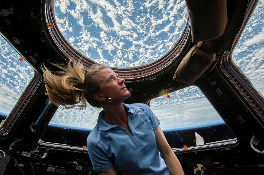 NASA astronaut Karen Nyberg enjoys the view of Earth from the windows in the Cupola of the International Space Station during her Expedition 37 mission in 2013. Photo: NASA / © 2013 NASA