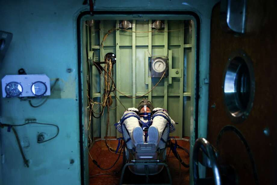 NASA astronaut Doug Hurley waits in a pressure chamber before a test of his Sokol space suit at the Zvezda facility on Wednesday, March 30, 2011, in Moscow. The crew of the final shuttle mission traveled to Moscow for a suit fit check of their Russian Soyuz suits that will be required in the event of an emergency. Photo: Smiley N. Pool, Houston Chronicle / © 2011  Houston Chronicle