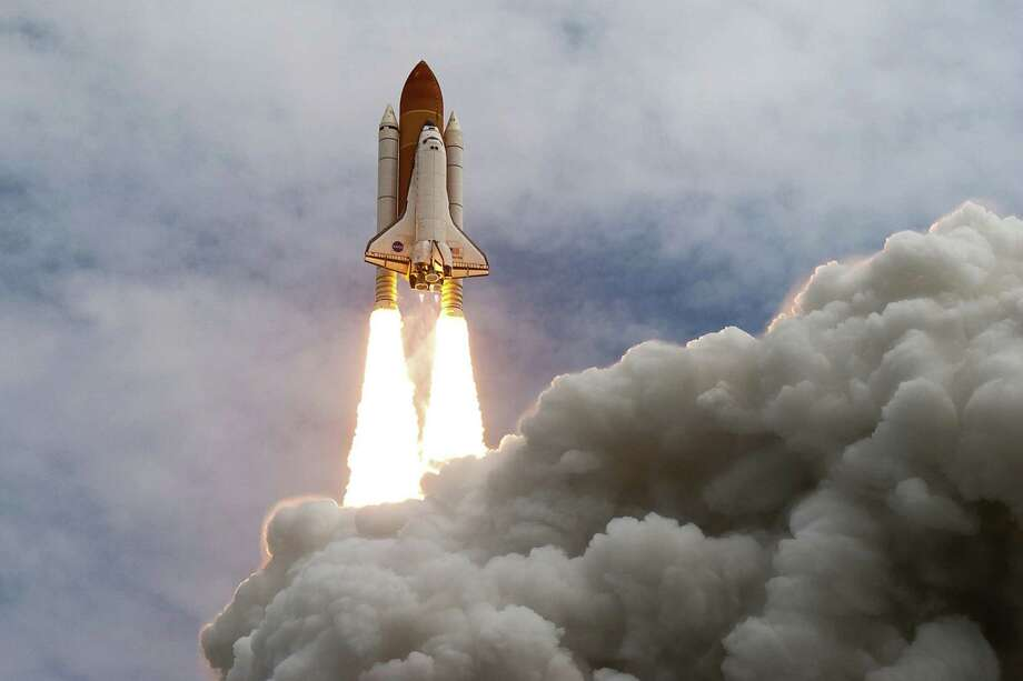 The space shuttle Atlantis launches for the STS-135 mission to the International Space Station in the final mission of the space shuttle program at the Kennedy Space Center in Florida on Friday, July 8, 2011. Photo: Smiley N. Pool, Houston Chronicle / © 2011  Houston Chronicle