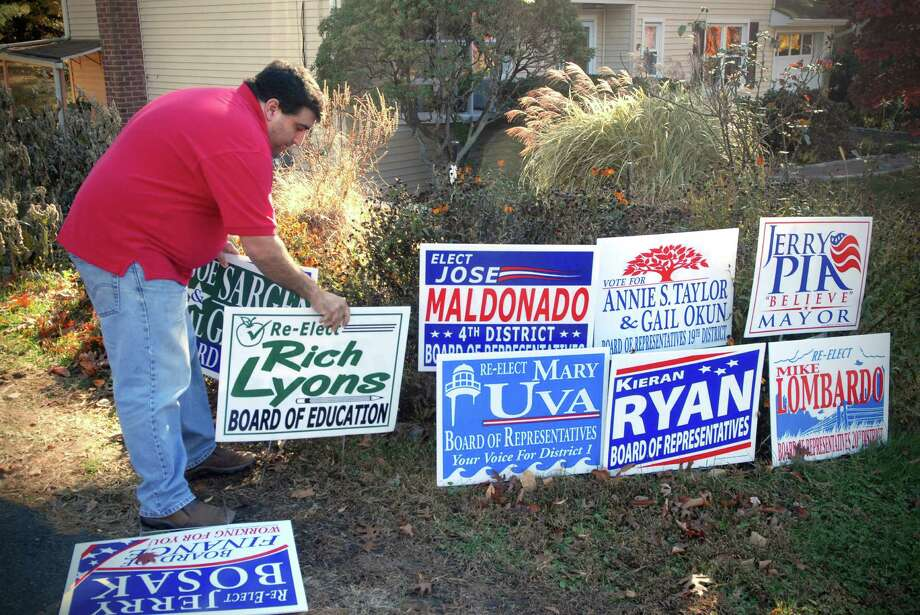 Vincent Murace runs a graphic design business from his Stamford, Conn. home and works on campaign signs and related campaign items. He's photographed on Monday November 4, 2013. Photo: Dru Nadler / Stamford Advocate Freelance
