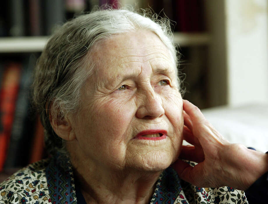 "FILE - In this April 17, 2006 file photo, Writer Doris Lessing, 86, sits in her home in north London. Doris Lessing, the free-thinking, world-traveling, often-polarizing writer of ""The Golden Notebook"" and dozens of other novels that reflected her own improbable journey across the former British empire, has died, early Sunday, Nov. 17, 2013.  She was 94. The author of more than 50 works of fiction, nonfiction and poetry, Lessing explored topics ranging from colonial Africa to dystopian Britain, from the mystery of being female to the unknown worlds of science fiction.   (AP Photo/Martin Cleaver, File) ORG XMIT: LON116 Photo: Martin Cleaver / AP"