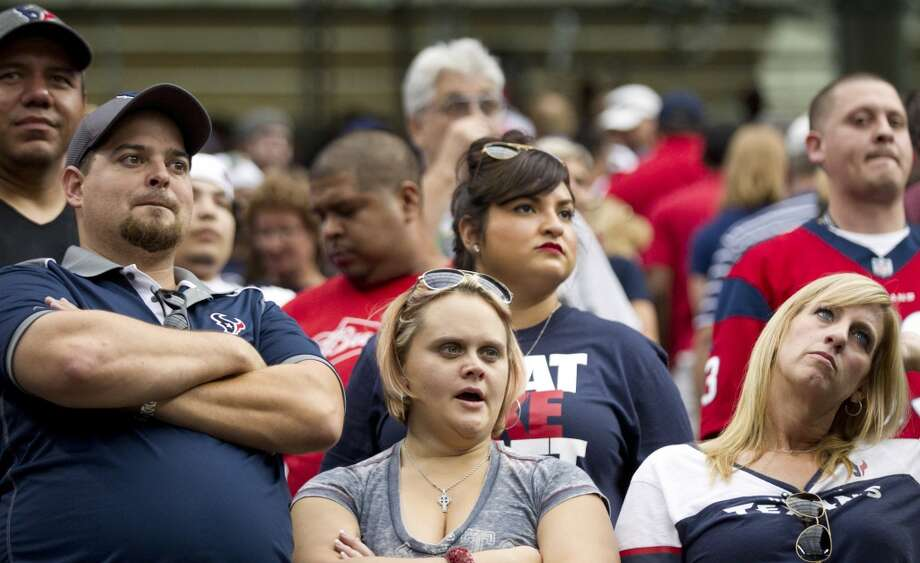 Texans fans look on as time runs out against the Raiders. Photo: Brett Coomer, Houston Chronicle