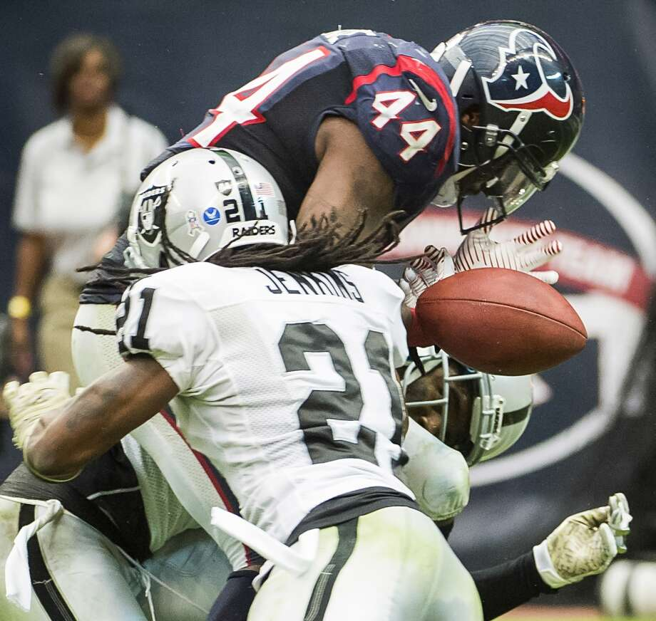 Texans running back Ben Tate fumbles at the goal line. He recovered the fumble, leaving the Texans with a third down at the Oakland two yard line. Photo: Smiley N. Pool, Houston Chronicle