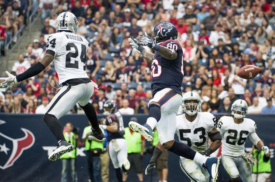 A pass in the end zone intended for Texans wide receiver Andre Johnson (80) goes incomplete as Raiders free safety Charles Woodson (24) defends. Photo: Smiley N. Pool, Houston Chronicle