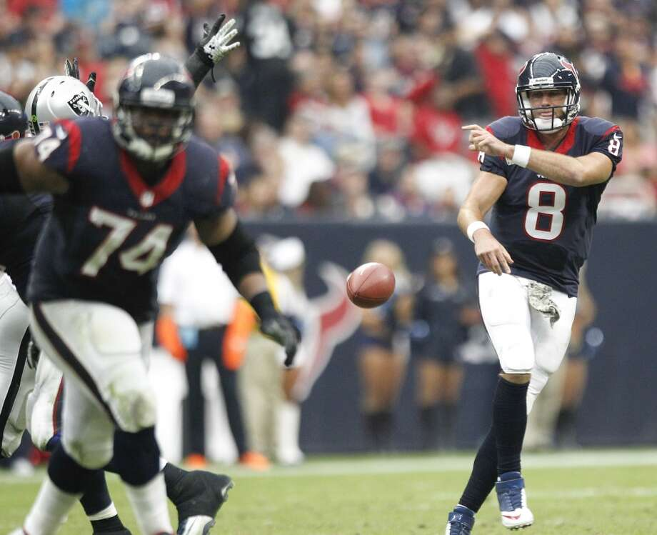 Texans quarterback Matt Schaub throws the ball into the ground during the fourth quarter. Photo: Brett Coomer, Houston Chronicle
