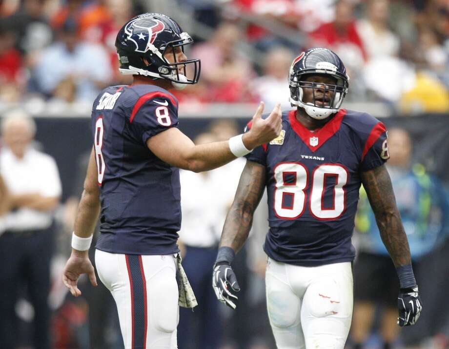 Texans quarterback Matt Schaub (8) and wide receiver Andre Johnson (80) go to the huddle during the third quarter. Photo: Brett Coomer, Houston Chronicle