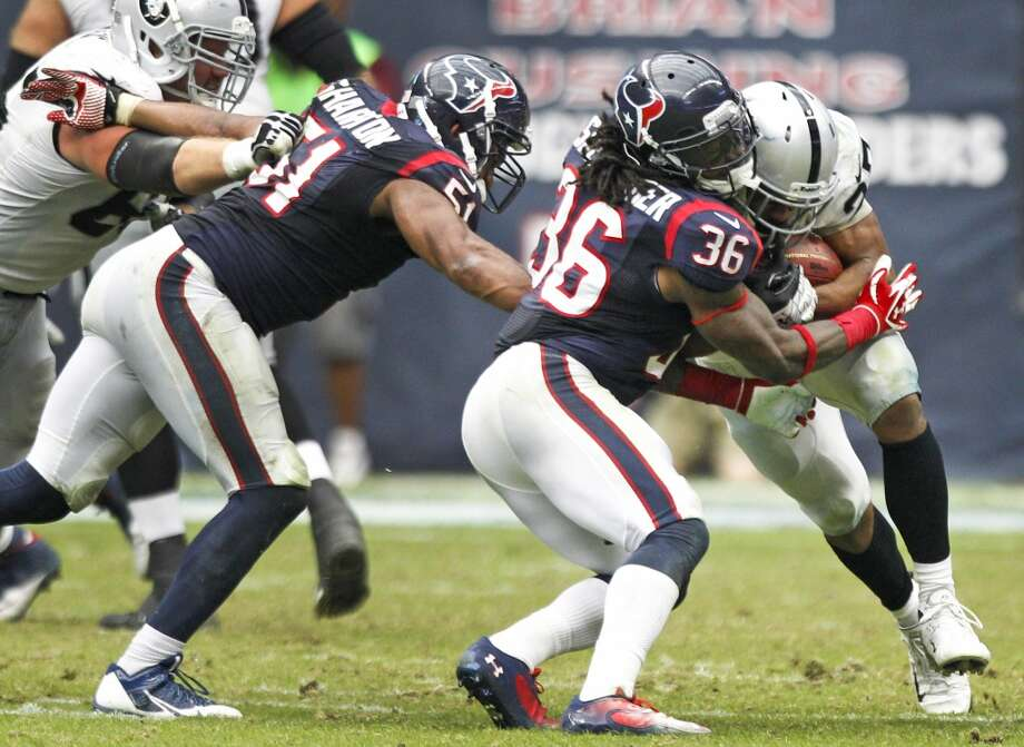Raiders running back Rashad Jennings breaks a tackle on a 80 yard touchdown run. Photo: Brett Coomer, Houston Chronicle