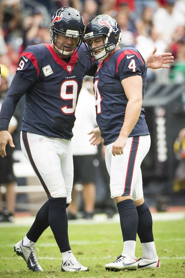 Texans kicker Randy Bullock (4) celebrates with punter Shane Lechler (9) after kicking a 51-yard field goal. Photo: Smiley N. Pool, Houston Chronicle
