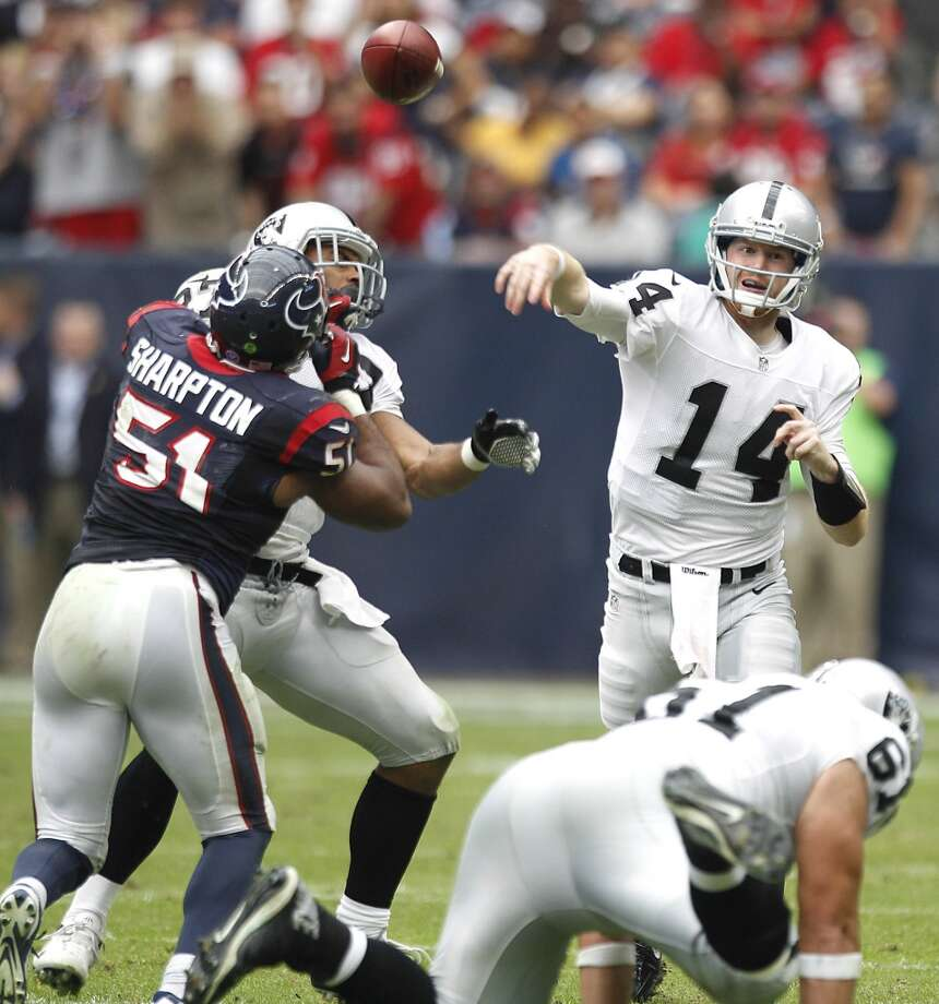 Raiders quarterback Matthew McGloin (14) throws a pass over Texans linebacker Darryl Sharpton. Photo: Brett Coomer, Houston Chronicle