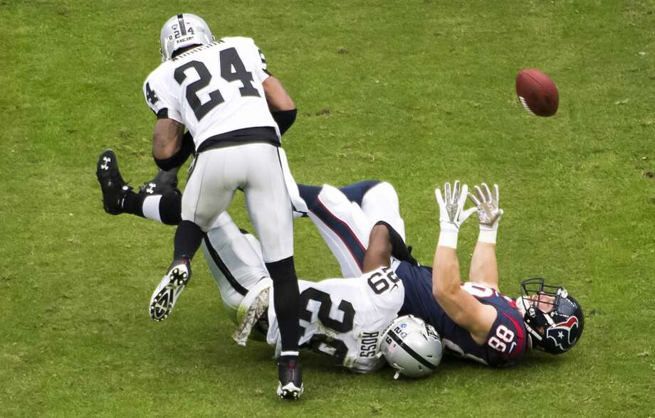 Texans tight end Garrett Graham (88) fumbles as he is hit by Raiders strong safety Brandian Ross (29). Photo: Smiley N. Pool, Houston Chronicle