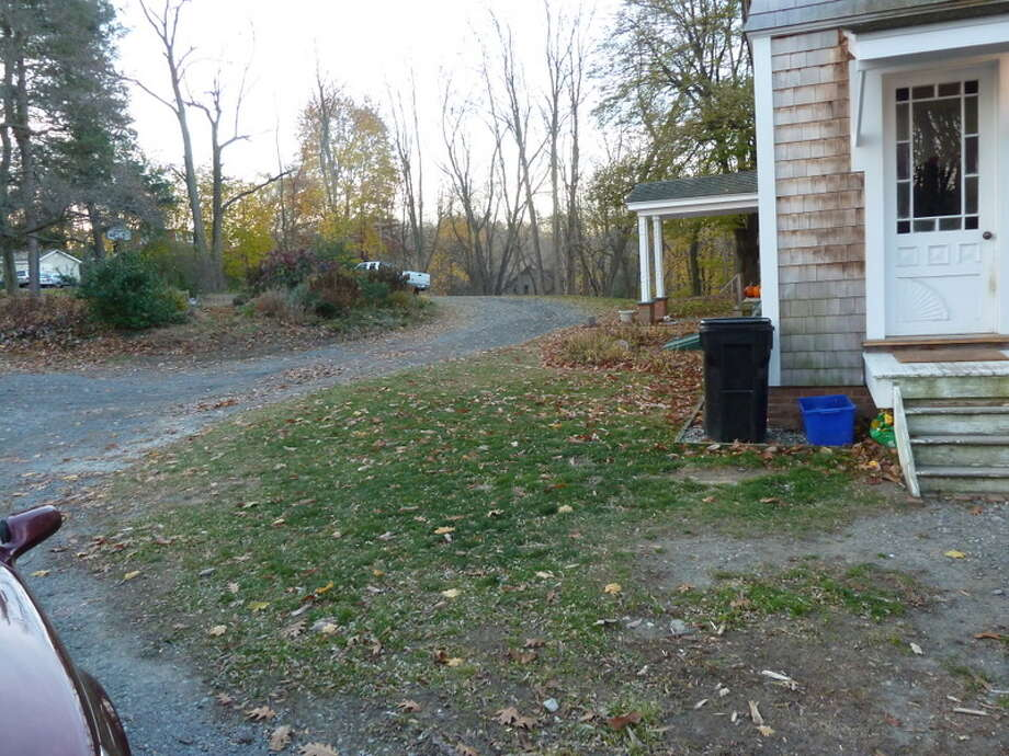 The driveway is getting a mini-makeover too. Some nice edging to create a line between driveway and yard. Photo: Picasa