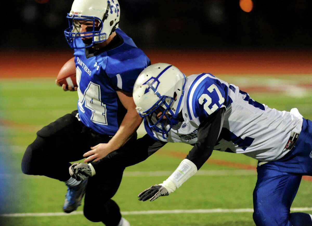 Hoosick Falls' Mike Matatt, left, carries the ball as Ogdensburg's Jon Taylor defends during their Class C regional football semifinal on Friday, Nov. 15, 2013, at Stillwater High in Stillwater, N.Y. (Cindy Schultz / Times Union)