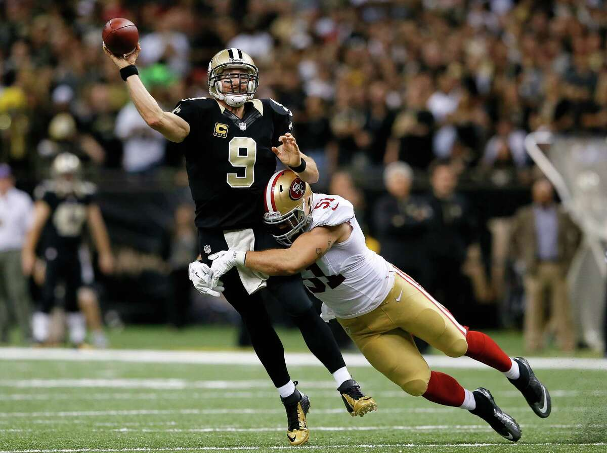 NEW ORLEANS, LA - NOVEMBER 17: Dan Skuta #51 of the San Francisco 49ers pressures Drew Brees #9 of the New Orleans Saints at Mercedes-Benz Superdome on November 17, 2013 in New Orleans, Louisiana. (Photo by Kevin C. Cox/Getty Images) ORG XMIT: 186620954