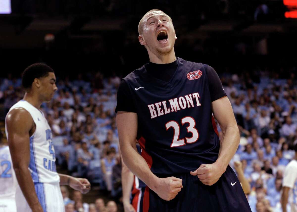 Belmont's Craig Bradshaw (23) reacts following a basket against North Carolina during the second half of an NCAA college basketball game in Chapel Hill, N.C., Sunday, Nov. 17, 2013. Belmont won 83-80. North Carolina's James Michael McAdoo walks away at rear. (AP Photo/Gerry Broome) ORG XMIT: NCGB107