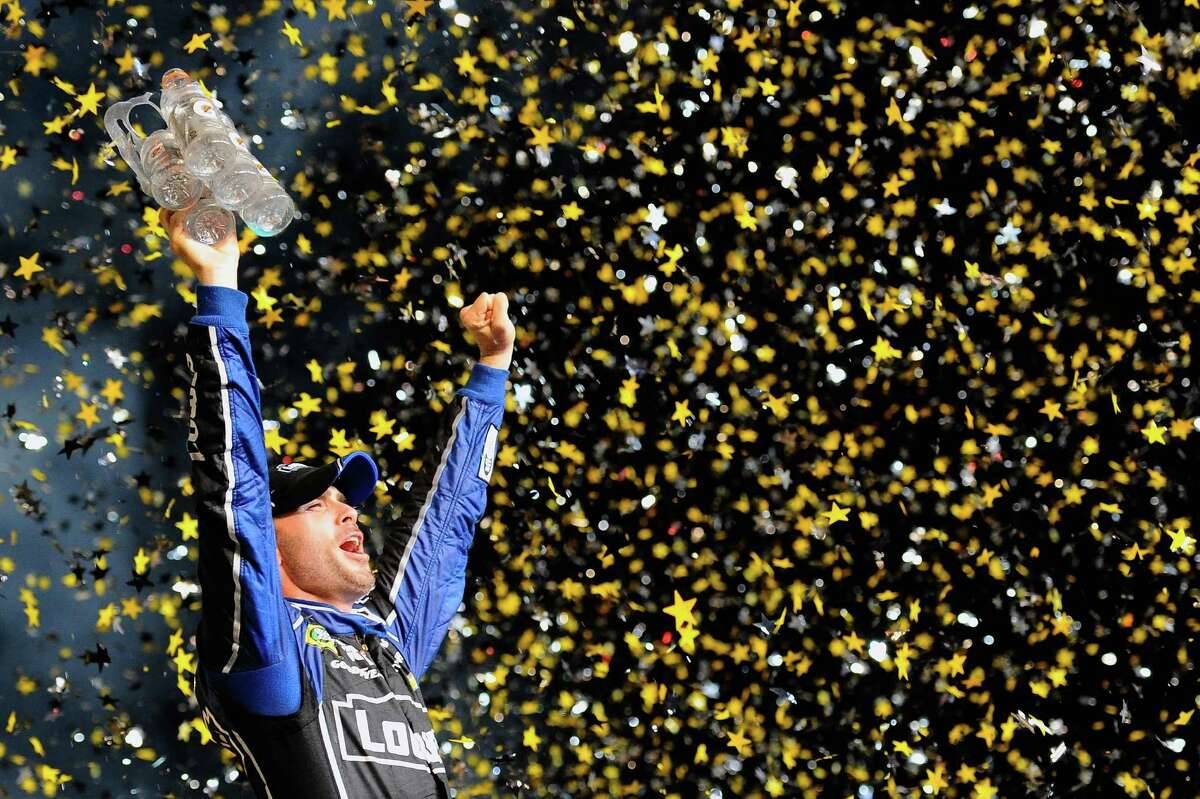 HOMESTEAD, FL - NOVEMBER 17: Jimmie Johnson, driver of the #48 Lowe's/Kobalt Tools Chevrolet, celebrates in Victory Lane after winning the series championship following the NASCAR Sprint Cup Series Ford EcoBoost 400 at Homestead-Miami Speedway on November 17, 2013 in Homestead, Florida. (Photo by Jared C. Tilton/Getty Images) ORG XMIT: 159337956