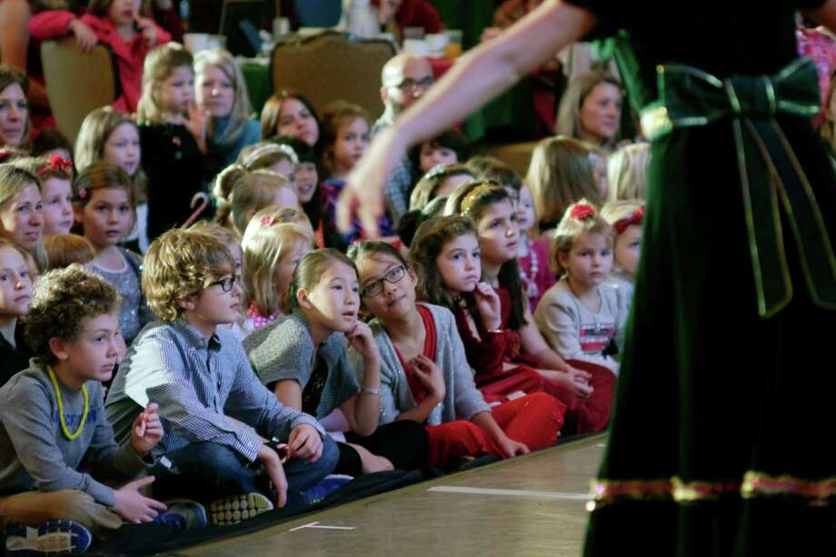 Children watch dancers perform during the Nutcracker Tea put on by the Northeast Ballet Company at the Hall of Springs on Sunday, Nov. 17, 2013 in  Saratoga Springs, NY.  The event benefits SPAC's performing arts education programs.   (Paul Buckowski / Times Union) Photo: Paul Buckowski / 00024670A
