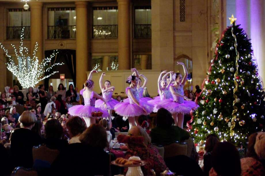 Dancers playing the part of sugar plum fairies, perform during the Nutcracker Tea put on by the Northeast Ballet Company at the Hall of Springs on Sunday, Nov. 17, 2013 in  Saratoga Springs, NY.  The event benefits SPAC's performing arts education programs.   (Paul Buckowski / Times Union) Photo: Paul Buckowski / 00024670A