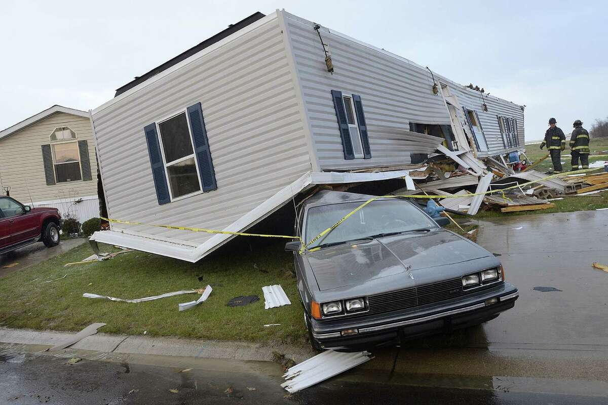 Firefighters look over damage to trailers at Summit Village east of Marion, Ind., after storms blew through Marion and Grant County on Sunday afternoon, Nov. 17, 2013. (AP Photo/Chronicle-Tribune, Jeff Morehead) ORG XMIT: INMAR103.JPG