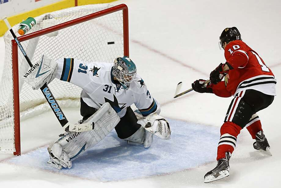 Patrick Sharp's penalty shot past Antti Niemi gives the Blackhawks their third and final third-period goal in their 5-1 win over the Sharks, who finished 3-1-1 on a five-game road trip. Photo: Andrew Nelles, Associated Press