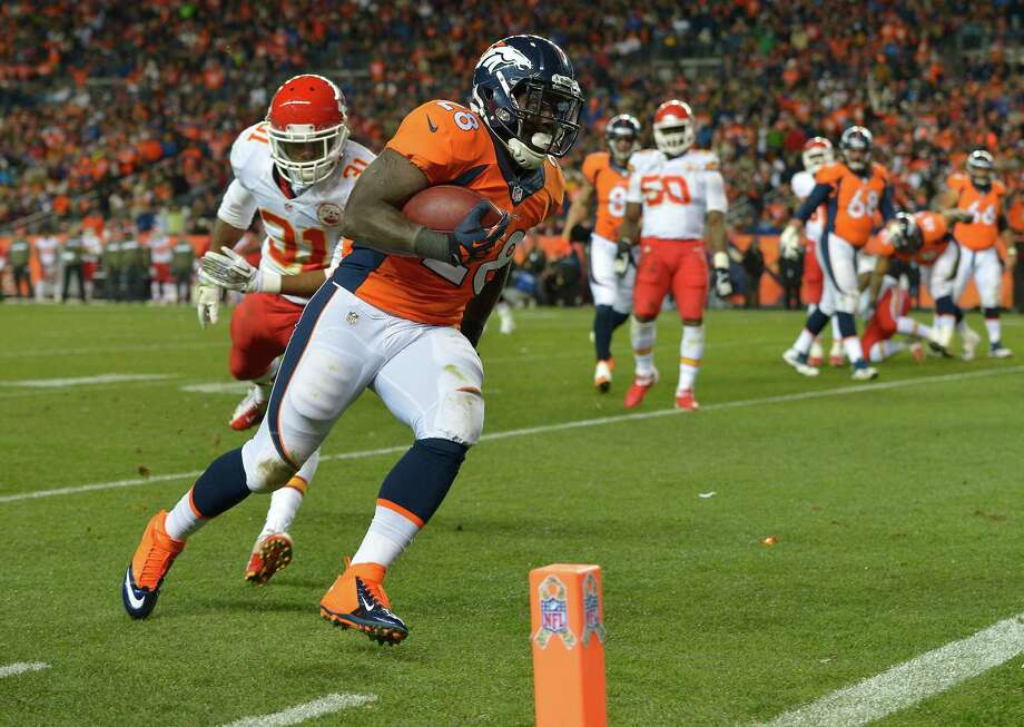 Denver Broncos running back Montee Ball (28) heads for the goal line for a touchdown against the Kansas City Chiefs in the third quarter of an NFL football game, Sunday, Nov. 17, 2013, in Denver. (AP Photo/Jack Dempsey) Photo: Jack Dempsey, Associated Press / FR42408 AP