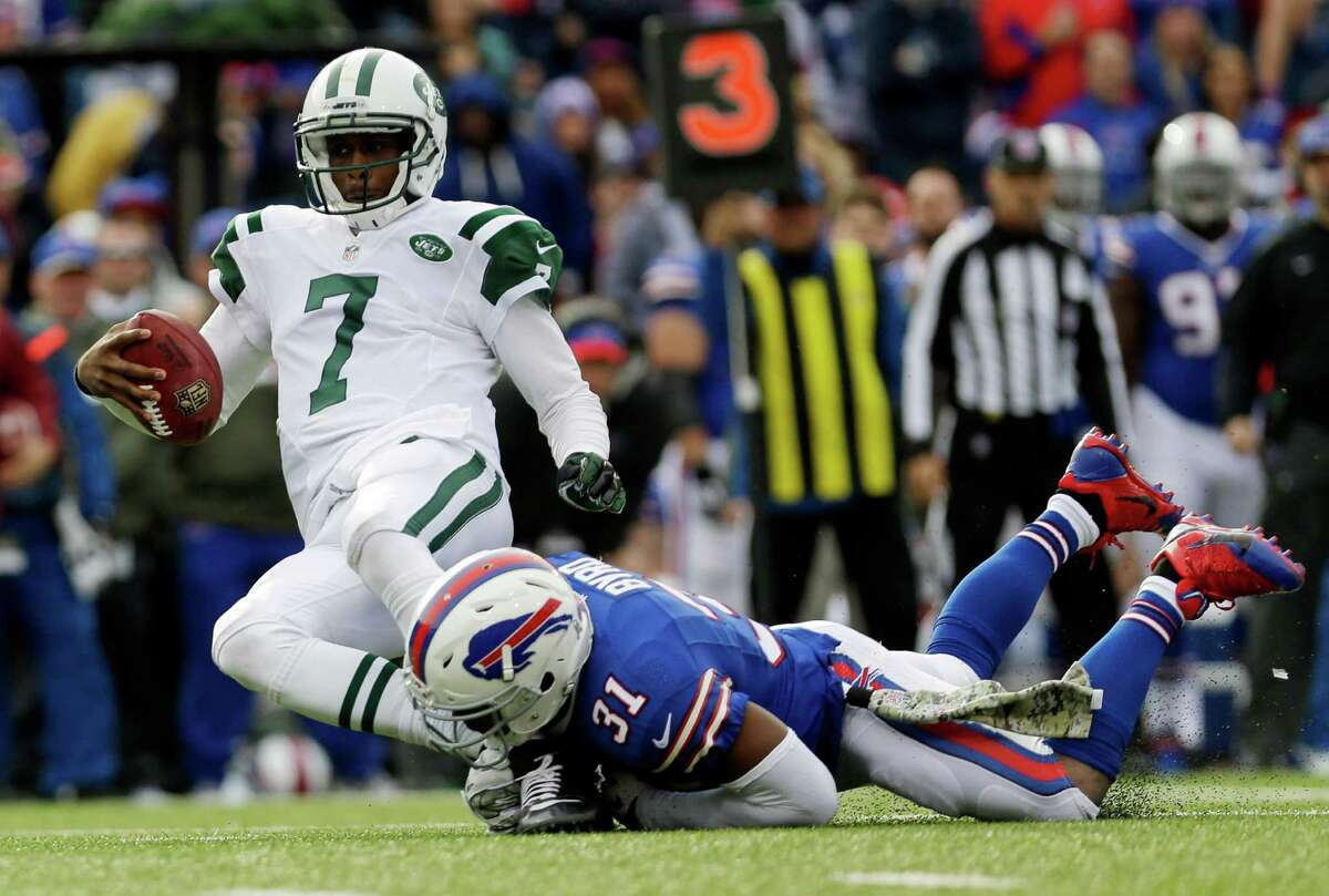 New York Jets quarterback Geno Smith (7) is sacked by Buffalo Bills free safety Jairus Byrd (31) during the first half of an NFL football game on Sunday, Nov. 17, 2013, in Orchard Park, N.Y. (AP Photo/Heather Ainsworth) ORG XMIT: NYMG110