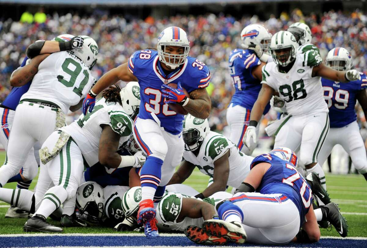 Buffalo Bills fullback Frank Summers (38) scores a touchdown against the New York Jets during the first half of an NFL football game on Sunday, Nov. 17, 2013, in Orchard Park, N.Y. (AP Photo/Gary Wiepert) ORG XMIT: NYMG108