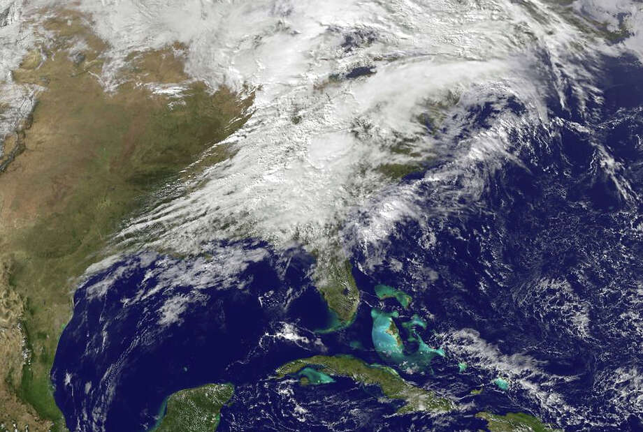 In this handout provided by NOAA, shows severe weather as it moves through the midwest area of the United States on Nomveber 17, 2013. A fast-moving storm system that produced at least one tornado in Illinois threatens 26 states and more than 100 million people with high winds and possible flash flooding. Photo: Handout, Getty Images / 2013 NOAA