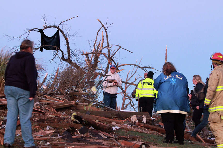 Residents of Elgin Avenue sort through debris after a tornado struck on November 17, 2013 in Washington, Illinois. Several tornadoes touched down across the Midwest today with at least three people reported dead in Illinois. Photo: Tasos Katopodis, Getty Images / 2013 Getty Images