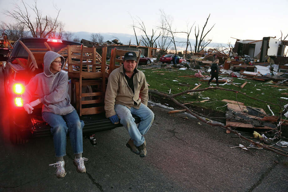 Tina Junk and Gary Junk, residents of Elgin Avenue, salvage what remains after a tornado struck on November 17, 2013 in Washington, Illinois. Several tornadoes touched down across the Midwest today with at least three people reported dead in Illinois. Photo: Tasos Katopodis, Getty Images / 2013 Getty Images
