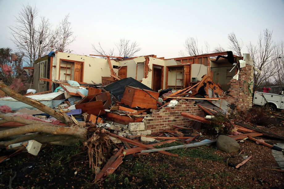 A home sits in ruin along Elgin Avenue after a tornado struck on November 17, 2013 in Washington, Illinois. Several tornadoes touched down across the Midwest today with at least three people reported dead in Illinois. Photo: Tasos Katopodis, Getty Images / 2013 Getty Images