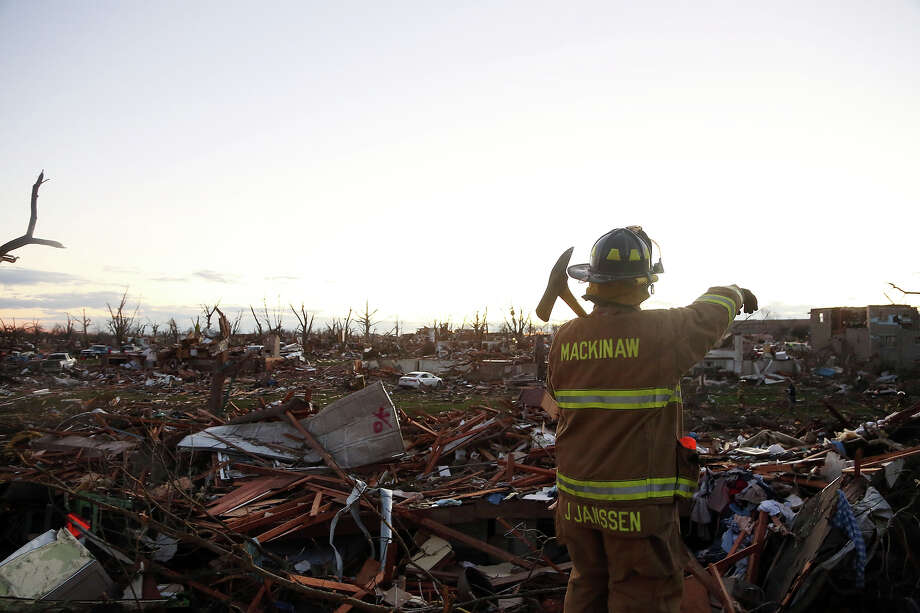 Jeremy Janssen of Mackinaw Fire Department works amongst the debris after a tornado struck on November 17, 2013 in Washington, Illinois. Several tornadoes touched down across the Midwest today with at least three people reported dead in Illinois. Photo: Tasos Katopodis, Getty Images / 2013 Getty Images