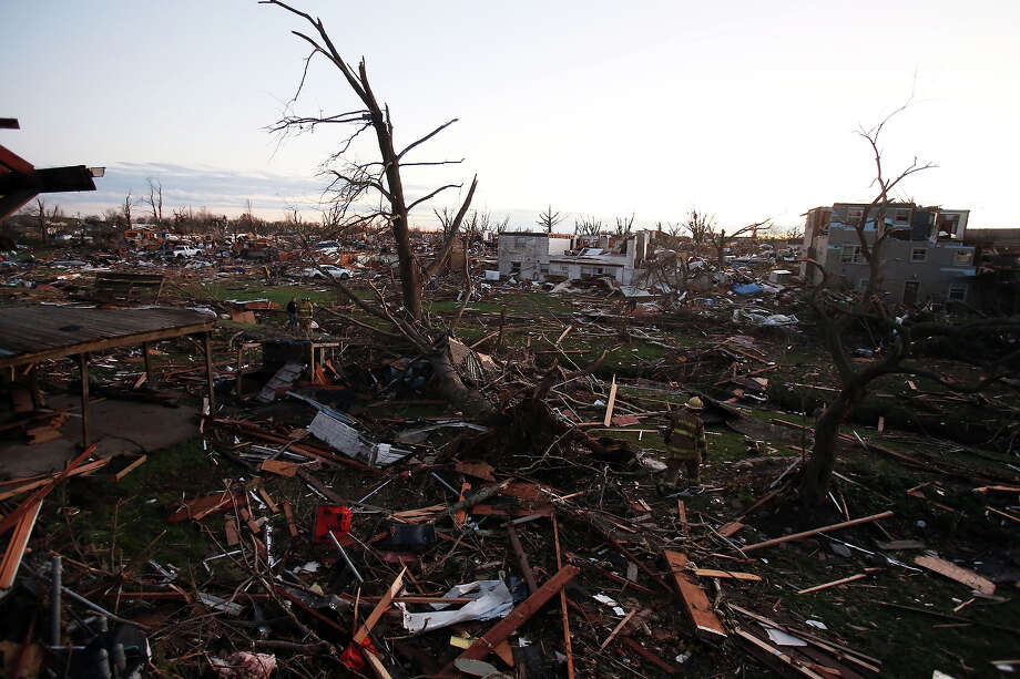 Debris covers the area after a tornado struck on November 17, 2013 in Washington, Illinois. Several tornadoes touched down across the Midwest today with at least three people reported dead in Illinois. Photo: Tasos Katopodis, Getty Images / 2013 Getty Images