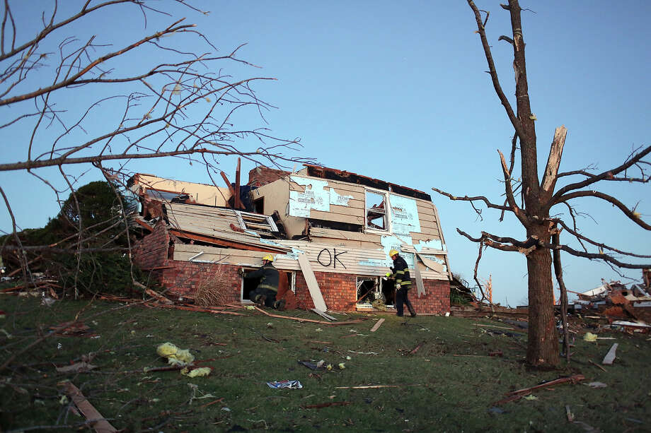 Firefighters search a heavily damaged home after a tornado struck on November 17, 2013 in Washington, Illinois. Several tornadoes touched down across the Midwest today with at least three people reported dead in Illinois. Photo: Tasos Katopodis, Getty Images / 2013 Getty Images