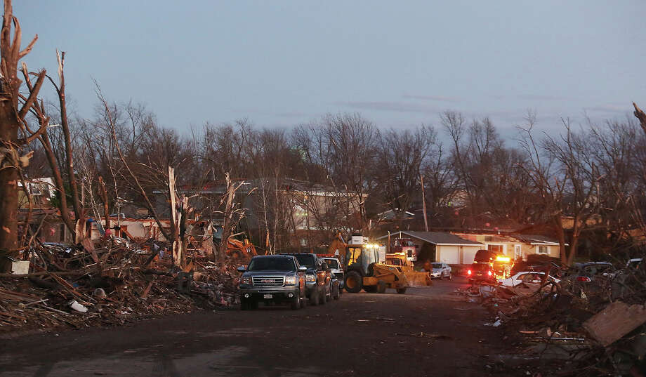 The damage is surveyed along Elgin Avenue after a tornado struck on November 17, 2013 in Washington, Illinois. Several tornadoes touched down across the Midwest today with at least three people reported dead in Illinois. Photo: Tasos Katopodis, Getty Images / 2013 Getty Images