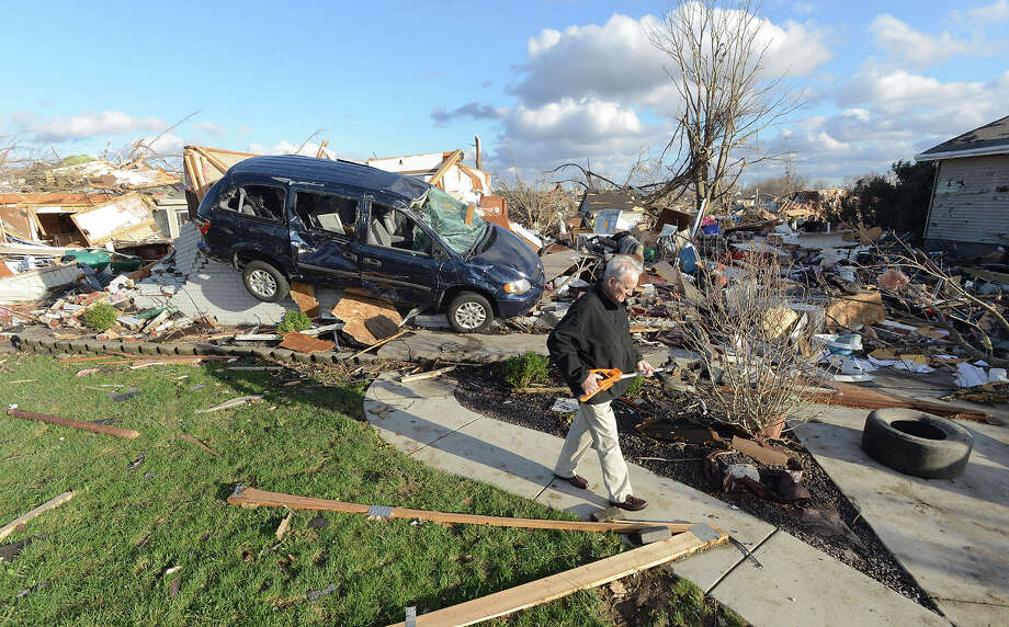 Richard Miller of Washington, Illinois salvages items from his brothers home, after a tornado leveled a subdivision on the North side of Washington, Ill., Sunday, Nov. 17, 2013. Intense thunderstorms and tornadoes swept across the Midwest, causing extensive damage in several central Illinois communities while sending people to their basements for shelter. Photo: Steve Smedley, AP / The Pantagraph