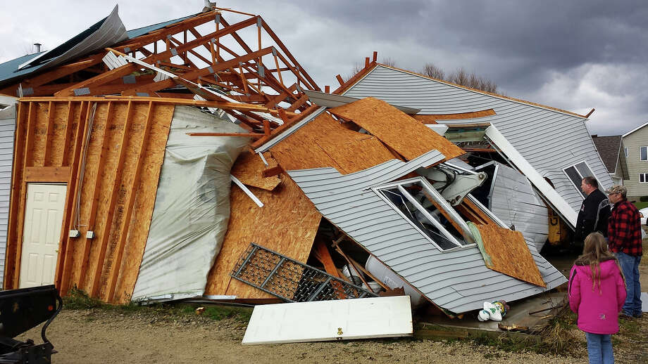 In a photo provided by Dodge County Emergency Management, A garage in the Town of Hustisford collapsed and walls were turned inside-out after severe weather moved through the area Sunday, Nov. 17, 2013. Intense thunderstorms and tornadoes swept across the Midwest on Sunday, causing extensive damage in several central Illinois communities while sending people to their basements for shelter. Photo: Joseph Meagher), ASSOCIATED PRESS / AP2013