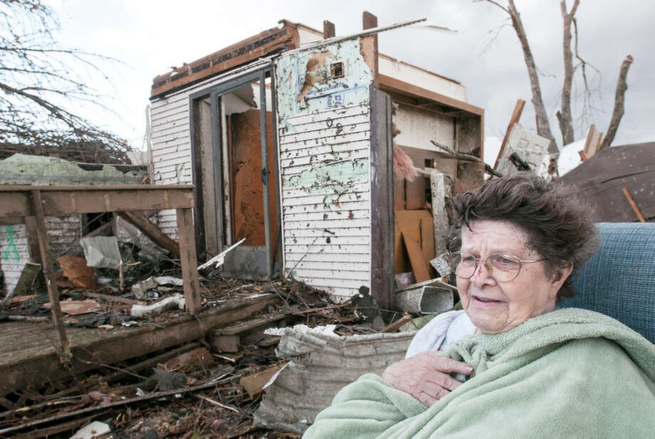 Pat Whitaker, 82, sits under a blanket in her nightgown outside her home waiting for help to come in Gifford, Ill. on Sunday, Nov. 17, 2013. Intense thunderstorms and tornadoes swept across the Midwest, causing extensive damage in several central Illinois communities while sending people to their basements for shelter. Photo: Robin Scholz, AP / The News-Gazette