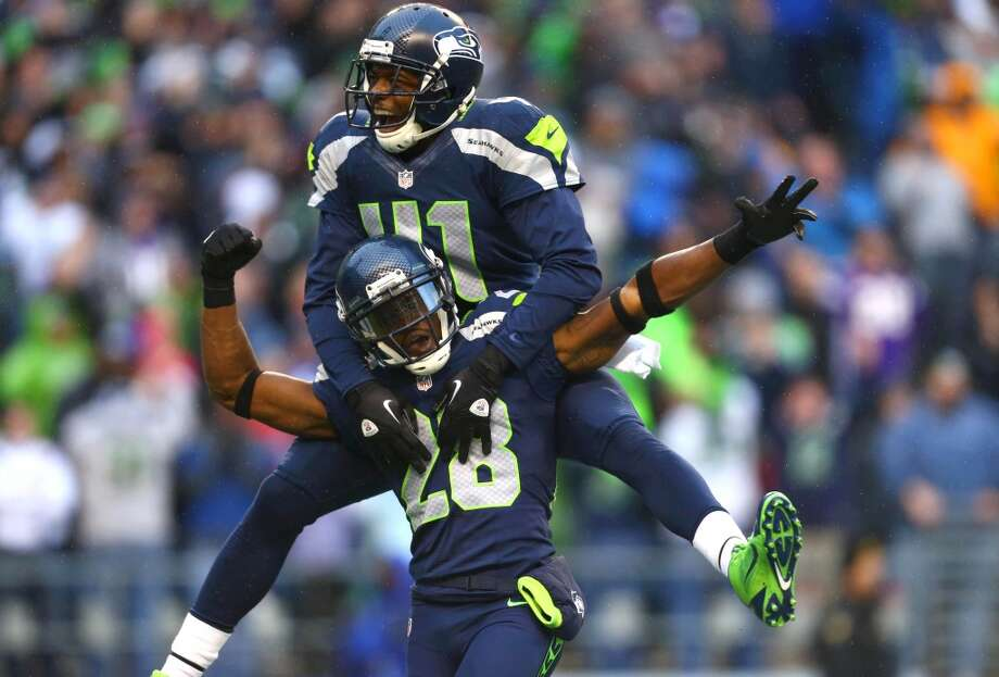 Seattle Seahawks player Thurmond Walter (28) and Byron Maxwell celebrate Thurmond's fourth quarter touchdown on an interception against the Minnesota Vikings. Photo: JOSHUA TRUJILLO, SEATTLEPI.COM