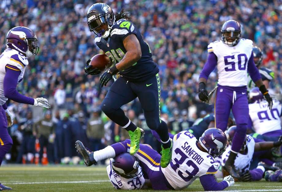 Seattle Seahawks player Marshawn Lynch leaps into the end zone for a first half touchdown against the Minnesota Vikings. Photo: JOSHUA TRUJILLO, SEATTLEPI.COM