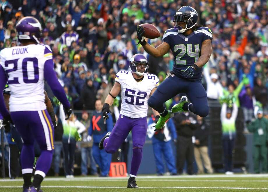 Seattle Seahawks player Marshawn Lynch leaps into the end zone for a fourth quarter touchdown against the Minnesota Vikings. Photo: JOSHUA TRUJILLO, SEATTLEPI.COM