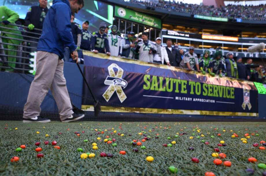 Stadium personnel clean up Skittles that rained down on the field after one of Marshawn Lynch's touchdown against the Minnesota Vikings. Photo: JOSHUA TRUJILLO, SEATTLEPI.COM