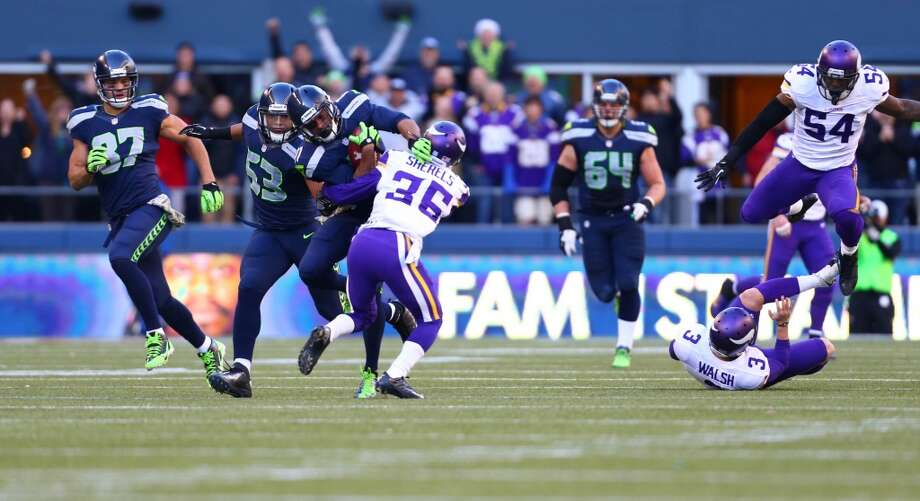 Seattle Seahawks player Percy Harvin gains yardage against the Minnesota Vikings on Sunday, November 17, 2013 at CenturyLink Field in Seattle.  (Joshua Trujillo, seattlepi.com) Photo: JOSHUA TRUJILLO, SEATTLEPI.COM
