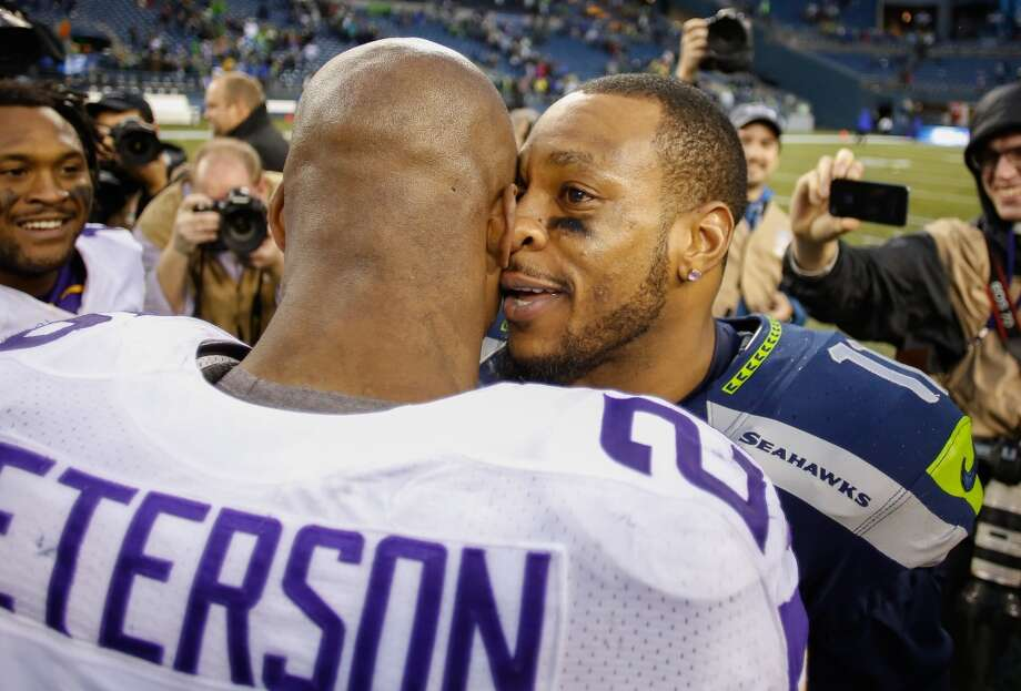 Wide receiver Percy Harvin (11) of the Seattle Seahawks (R) is greeted by running back Adrian Peterson (28) of the Minnesota Vikings after the Seahawks defeated the Vikings 41-20 at CenturyLink Field. Photo: Otto Greule Jr, Getty Images