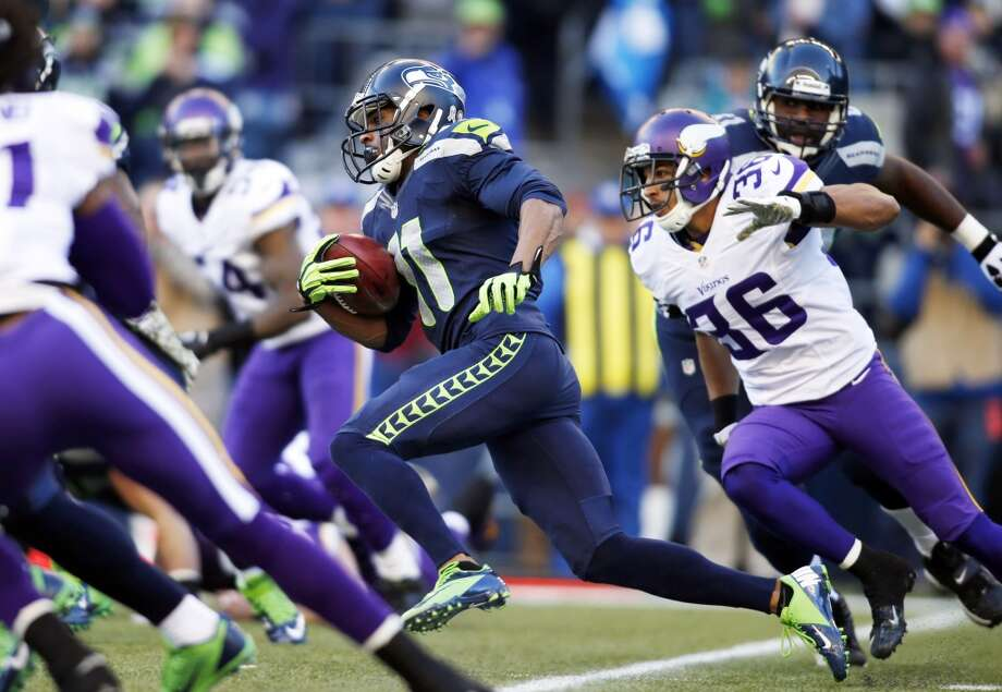 Seattle Seahawks' Percy Harvin (11) returns the ball against the Minnesota Vikings on a kick off in the first half of an NFL football game Sunday, Nov. 17, 2013, in Seattle. (AP Photo/John Froschauer) Photo: John Froschauer, ASSOCIATED PRESS