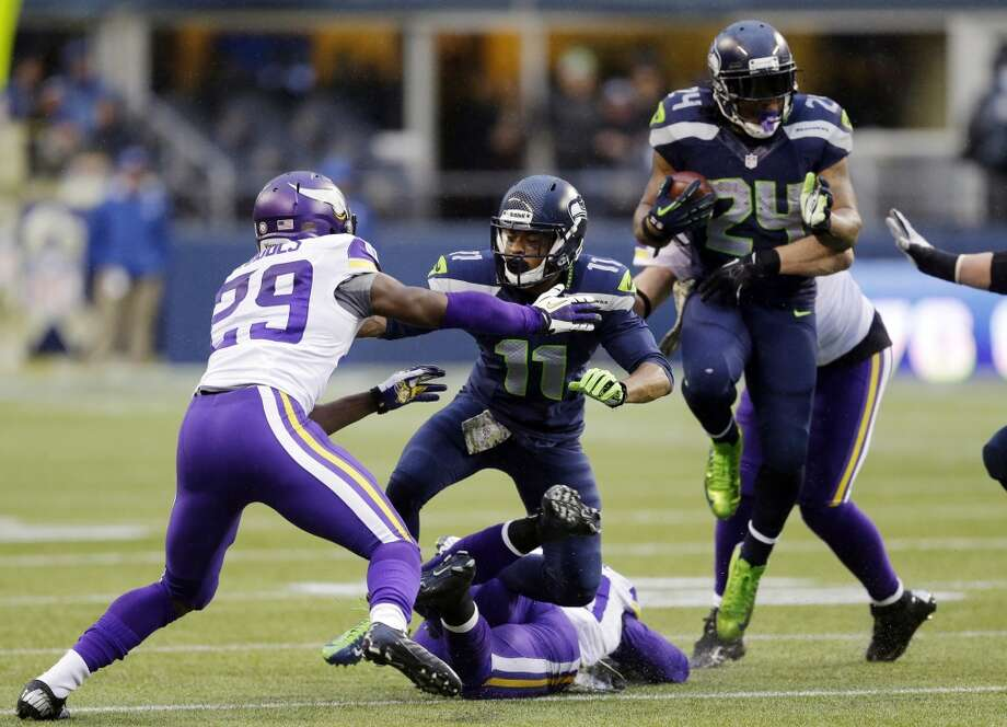 Seattle Seahawks' Percy Harvin (11) blocks Minnesota Vikings' Xavier Rhodes (29) as Seahawks' Marshawn Lynch rushes behind in the second half of an NFL football game Sunday, Nov. 17, 2013, in Seattle. (AP Photo/Ted S. Warren) Photo: Ted S. Warren, AP